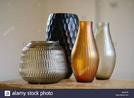 group of four decorative cut glass vases in a room stock photo