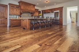 rustic wide plank hardwood flooring in kitchen with and