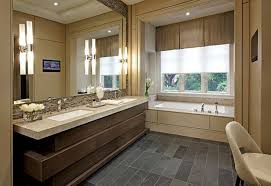bathroom brown bathroom vanities gray wall lamp white bathtubs