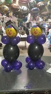 a three tier balloon creation for a graduation party balloon