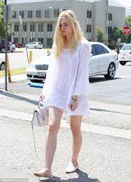 elle fanning steps out in second white peasant dress in six days