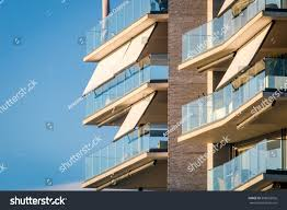 modern architecture building facade curtains awnings stock photo