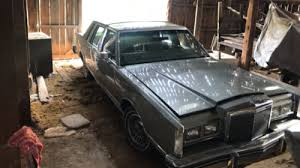 Barn Full Of Classic Cars Still In The Barn 1984 Town Car With 15 279 Miles