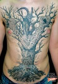 grey ink tree on chest tree torso for