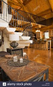 living room table bleached wooden stairs black wrought iron