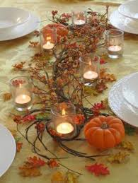 thanksgiving table with assorted turkey plates plaid tablecloth