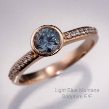 light blue sapphire engagement rings teal blue montana sapphire gold bezel pave