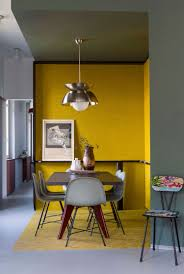 smart modern kitchen diner with mustard yellow feature wall room