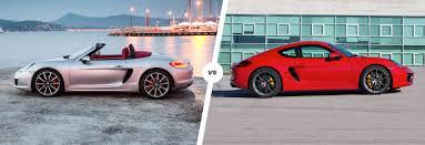 porsche cayman s vs boxster s porsche boxster vs cayman driver s car duel carwow