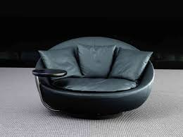 Round Armchair Round Black Leather Chair With Curving Back Also Cushions Combined