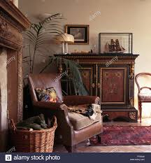 Antique Living Room Chairs Brown Leather Chair And Ornate Antique Cupboard In Fashioned