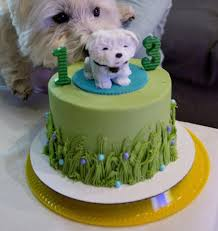 birthday cake for dog in green grass color with likeness of dog as
