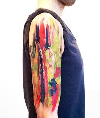 watercolor abstract painting tattoo on half sleeve