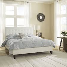 the waverly platform bed is upholstered with white faux leather