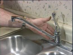 fixing leaky kitchen faucet repairing a faucet