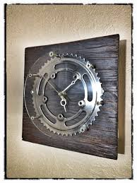 homemade clock from scrap wood bike parts and clock parts from a
