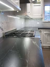 kitchen with marble backsplash and soapstone countertops