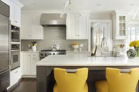 gray kitchen island with canary yellow counter stools