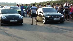 nissan 350z nismo hp bmw 335i convertible vs nissan 350z nismo youtube