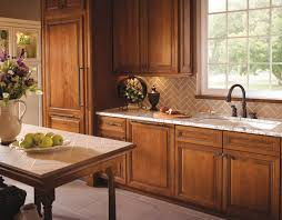 warm wood kitchen gives a traditional aesthetic to a beautiful