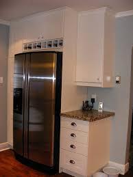 wine rack cabinet over refrigerator wine cubbies above fridge extended depth cabinet above wine