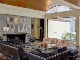 stone fireplace surround open white sofa wood walls seating area