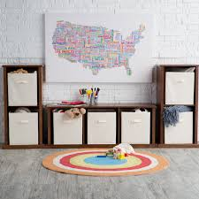 simple playroom with walnut toy storage wall unit and ivory