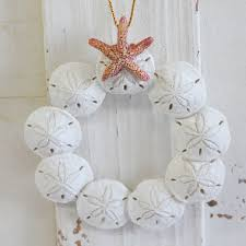 glass ornament with sand seashells coastal