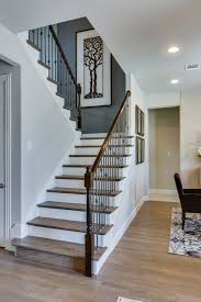gehan homes stairway light rustic hardwood tread white risers