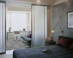bedrooms apartment bedroom with dark bedding style and frosted