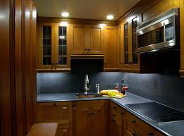 yellow brown cabinetry in small modern u shaped kitchen design