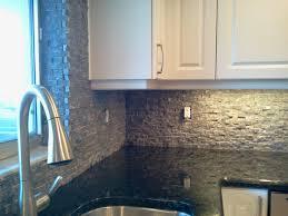 natural stone kitchen backsplash combined with black full bull