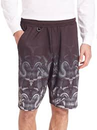 lamborghini clothing marcelo burlon lamborghini snake print shorts in black for men lyst