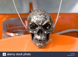 pewter skull ornament on a volkswagen beetle stock photo