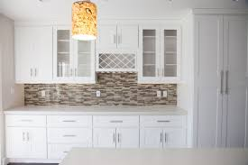 superb decorating ideas kitchen with brick backsplash kitchen backsplash tile ideas comely decorating using cylinder brown hanging pendants and rectangular white wooden cabinets also with grey