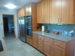 beechwood kitchen cabinets natural beech wood shaker galley refrigerator wall after craftsman