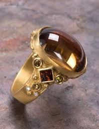 zircon rings images The golden eye golden zircon ring jpg