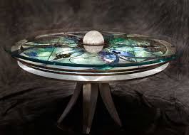 dining table with rotating three layer rotating glass kaleisoscope table