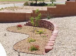 Southwest Landscape Design by Desert Southwest Landscaping On A Small Hillside Circular Driveway
