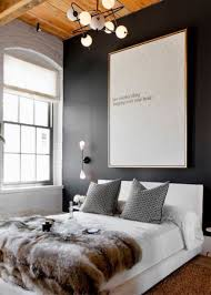 black wall accent in the modern bedroom with large wall decor and black wall accent in the modern bedroom with large wall decor and white modern bed