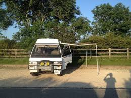 rare 4x4 mitsubishi delica l300 campervan with pop up roof cabin