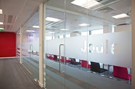 office interior design with glass wall partition walls and f door