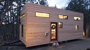 elegant minimalist tiny house on wheels with staircase