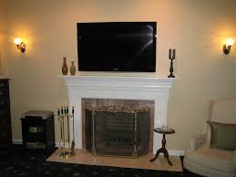 living black fireplace and wall television placed on the brown