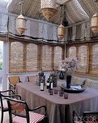 classic diing room with moroccan ambiance bamboo blind and rattan