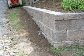 fresh build retaining wall against house 24665