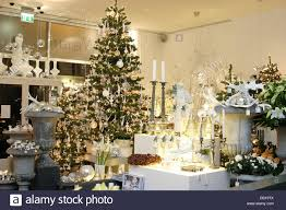 a christmas tree decorated with white accessories and more