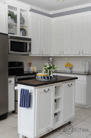 Backsplash Is It Worth Painting Kitchen Cabinets Remodelaholic