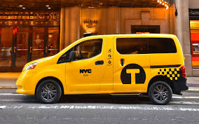 yellow nissan truck nissan braunability partner for wheelchair accessible taxi