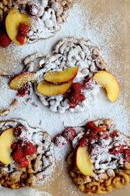 cinnamon sugar funnel cake with peaches and raspberries joy the